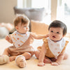 cute babies wearing the wee bean organic cotton bandana bibs in fish ball and red bean pudding