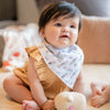 cute baby wearing the wee bean organic cotton bandana bib in white rabbit candy