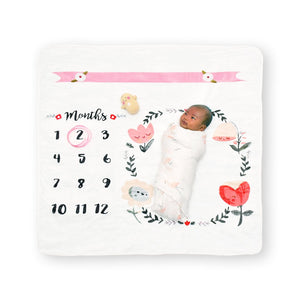baby laying on cute flowers milestone photo blanket the wee bean