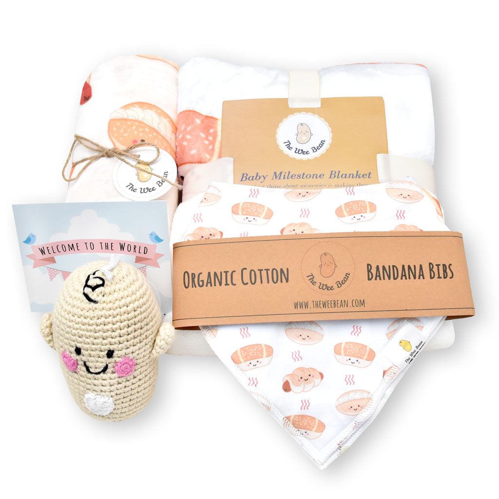 the wee bean welcome baby newborn gift set bakery buns sausage bun cocktail bun coconut cream bun organic swaddle milestone blanket organic cotton bandana bibs fair trade rattle doll