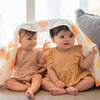 cute babies playing peekaboo in the wee bean iced gem biscuit belly button cookies organic cotton bamboo swaddle