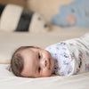 cute baby swaddled in the wee bean organic cotton bamboo super soft swaddle in white rabbit candy taste of hong kong