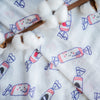cute baby swaddled in the wee bean organic cotton bamboo super soft swaddle in white rabbit candy taste of hong kong sustainble