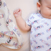 the wee bean organic cotton onesie romper bodysuit in white rabbit candy matching with organic cotton and bamboo swaddle