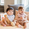 cute babies playing together wearing the wee bean organic cotton bandana bib in white rabbit candy and mr softee ice cream