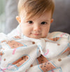 cute baby snuggling up in the wee bean super soft organic cotton and bamboo swaddle in boba bubble tea