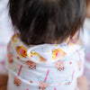 cute baby wearing the wee bean organic cotton bib in egg waffle sundae adjustable snap button