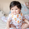 cute baby smiling in organic cotton bandana bib in egg waffle ice cream sundae