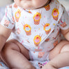 cute baby wearing the wee bean organic cotton bib in egg waffle sundae close up