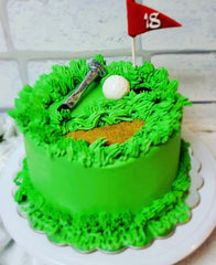image of golf themed cake for a parent & me cake decorating class