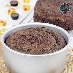 image of a chocolate caked baked in a round cake pan that is 3 inches deep