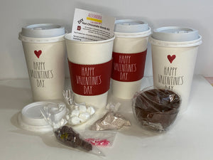 picture of a do it yourself hot cocoa bomb kit. Picture includes 2 chocolate shells, cocoa mix, marshmallows, sprinkles and a cute cocoa cup