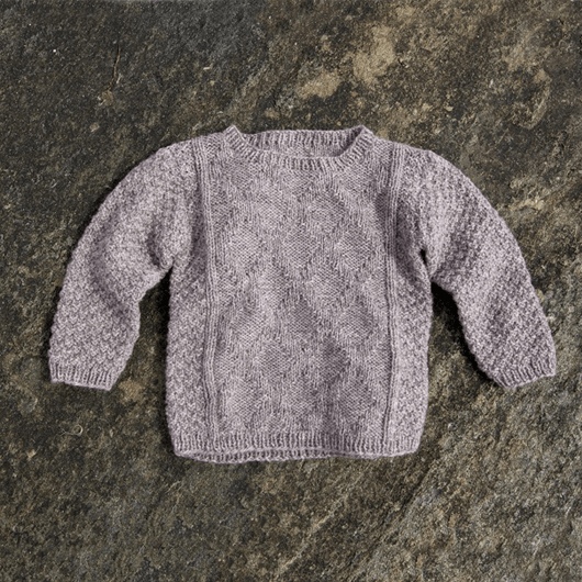 Warm knit for cool kids af Susie Haumann