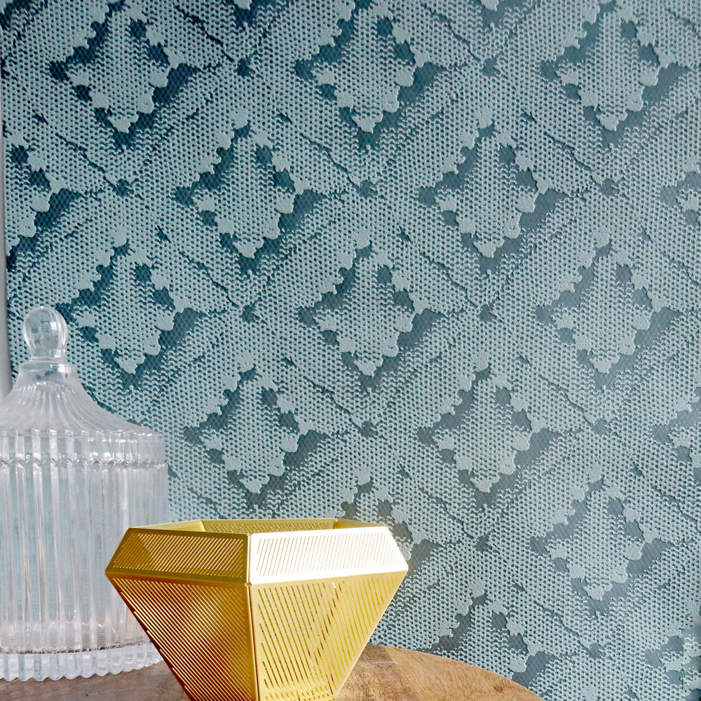 Stunning Lace Effect Geometric Blue / Teal & Metallic Wallpaper in Ikat DesignA contemporary modern take on the asian Ikat design trend in a stunning, contemporary, bang on trend Lace effect!This geometric wallpaper design features shimmering gloss highlights mixed with a matte fabric effect - simple yet detailed and striking at the same time. This gorgoeus mini ikat pattern would add a real impact to your home or even workspace.h10m x w52cm