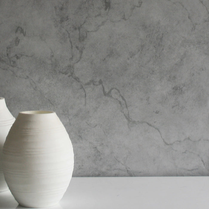 Marble Effect Wallpaper in Light Grey & Dark GreyFor the trend conscious amongst us marbled effects are where it is at this season, but the look can be difficult to achieve on a wall - until now. This bang on trend combination of light grey and dark grey creates real subtle effect! This is a flat wallpaper and looks so realistic!  L:10m x W:52cmPattern Repeat: 53cmThis is a washable wallpaper and is a paste the wall product