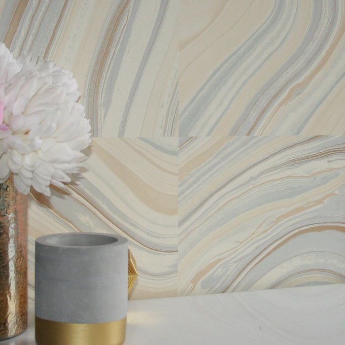 Marble Effect Wallpaper  Stunning Agate tile effect wallpaper, swirls of patterned flow through the tiles. Amazingly realistic this Agate effect Wallpaper looks close to the real thing! Being a washable wallpaper, it can be used in Bathroom and Kitchen. This a paste the wall wallpaper. It is just stunning when the light hits it as it is full of iridescent pearl sections and it shines like the real thing! We have included some images when the light hits it.h:10m x w:52cmPattern Repeat 53cm