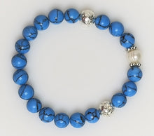Bracelet in turquoise beads and silver metal plated lava with freshwater pearl.