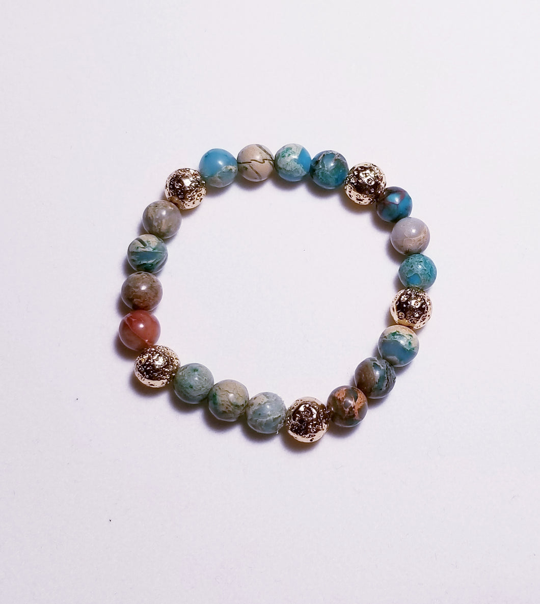 Natural stone bracelet with blue aqua terra jasper beads and gold metal plated lava beads