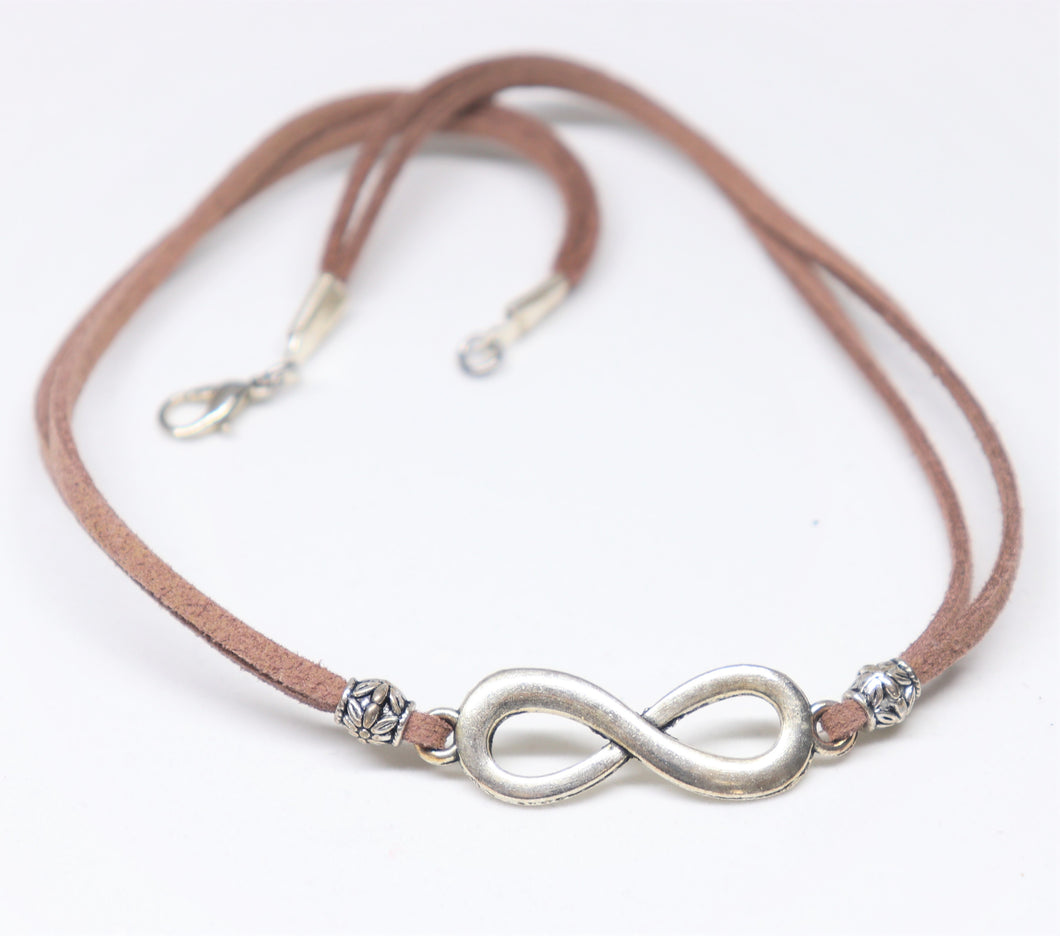 infinity sign with brown suedine choker