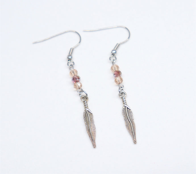 stainless steel hook earrings with champagne round cut cristal holding a feather