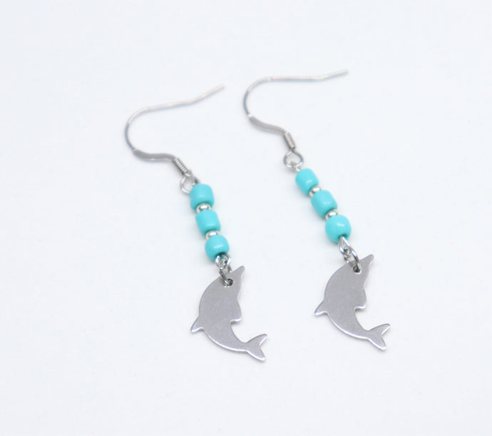 hook stainless steel long earring with blue rockery glass beads holding a dolphin