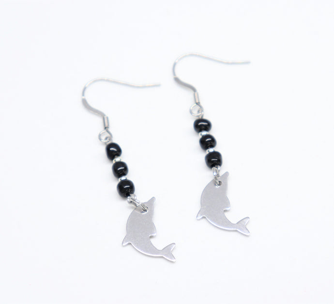 stainless steel hook earrings with black rockery glass bead holding a dolphin