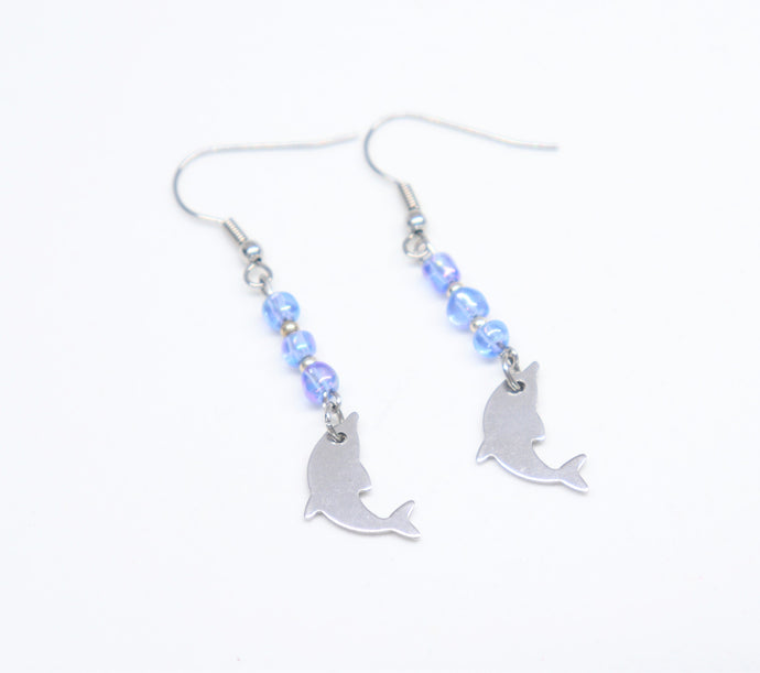 stainless steel hook earrings with changing blue rockery glass bead holding a dolphin
