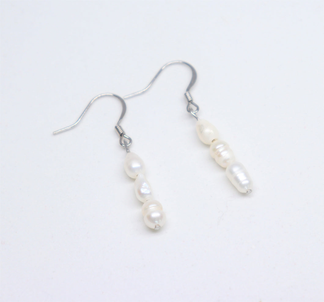 Long earrings with three rice type freshwater pearls. Hypoallergenic with stainless steel fish hook