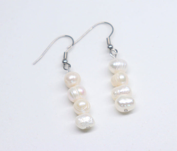 Long earrings with three round freshwater white pearls. Hypoallergenic with stainless steel fish hook