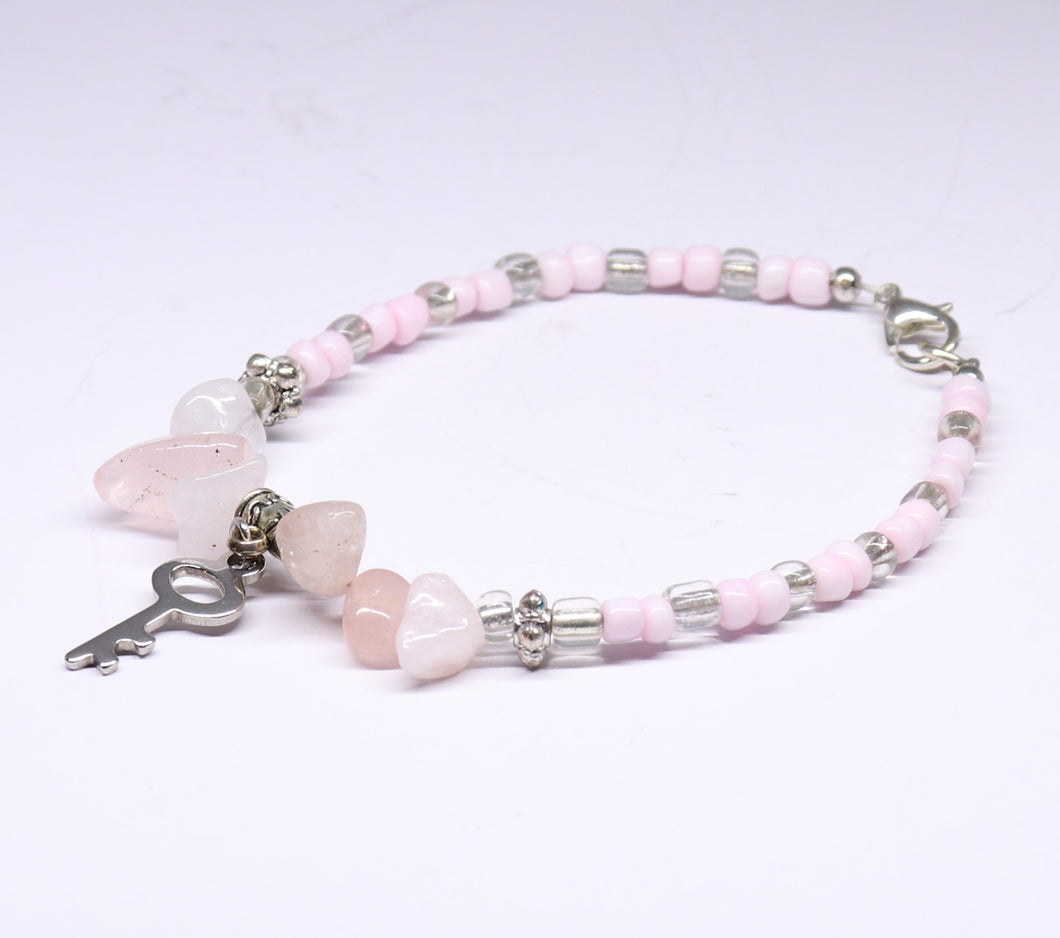 pink quart with rockery glass bead and key pending charm bracelet