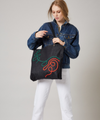 Thick denim tote bag with elaborate swirls in brightly coloured braided cord