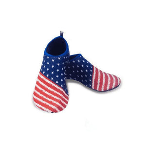 Slick and flexible slip on water shoes with rubber soles that have an American Flag Design across the entire top of the shoes with red and white stripes with the classic American blue with stars on the back half of the shoe.