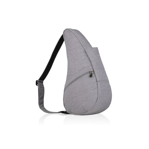 A healthy back bag shown from the side view in pebble grey textured nylon