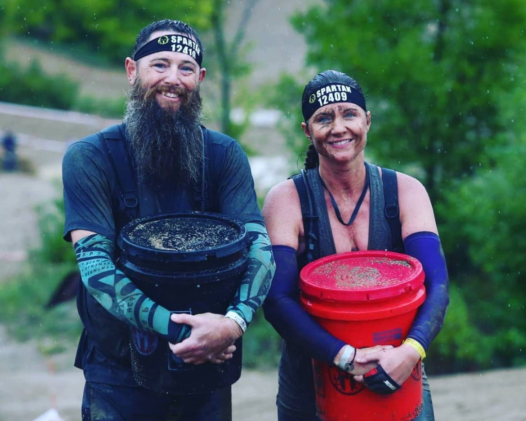 bucket carry at Spartan Race with Race Ready Obstacles LLC