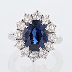 Nazarelle 18 Karat White Gold 6.46 Carat Certified Oval Vivid Blue Sapphire and Diamond Ring - Nazar's & Co.