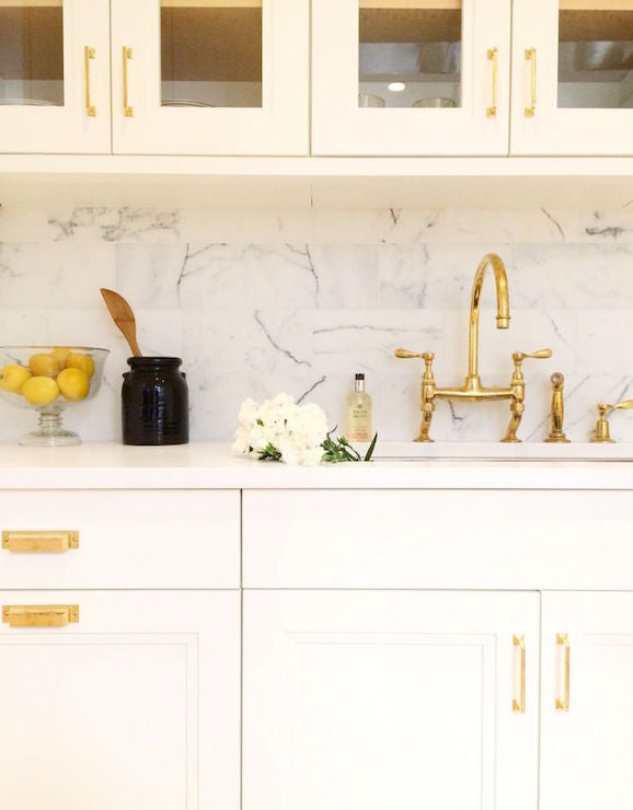 White kitchen with gold accents
