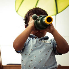 Little kid looking through the binoculars