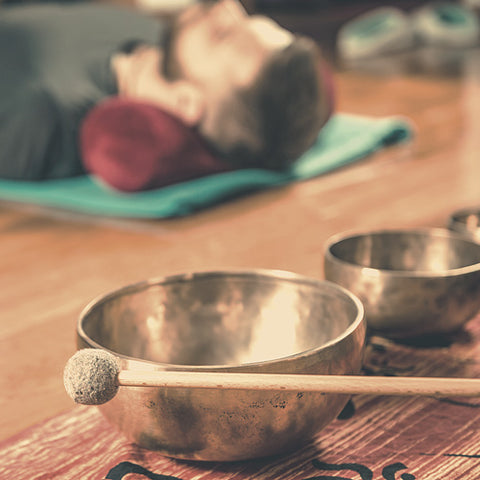 Group meditation with Tibetan singing bowl