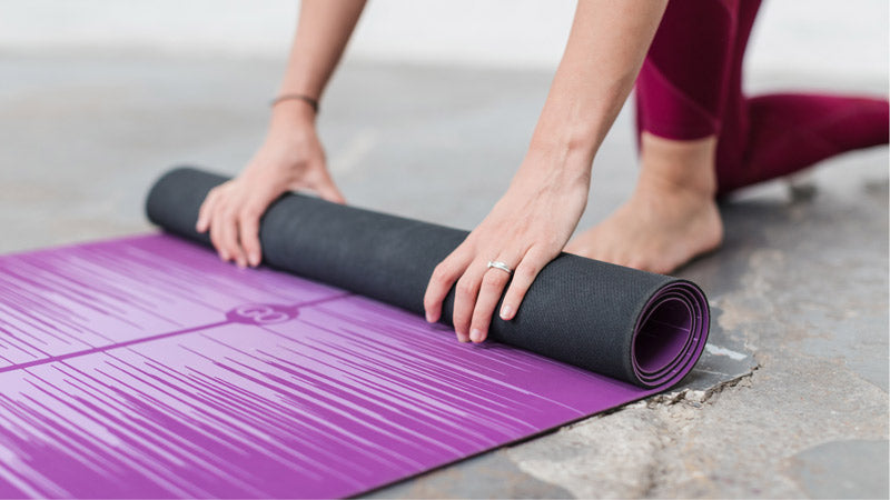 Purple PU top yoga mat, half rolled for the text about care and use of PU alignment yoga mats