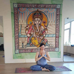 Vilnius Yoga teacher on Mandala rainbow yoga mat