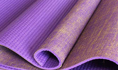 Half rolled purple PVC yoga mat with jute top layer
