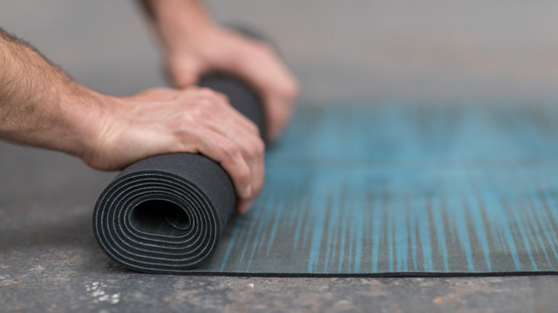 rolled yoga mat ocean blue