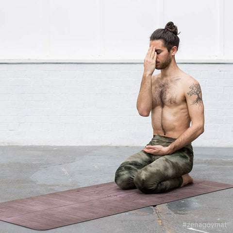 Yoga teacher doing pranayama breathing on the best yoga mat