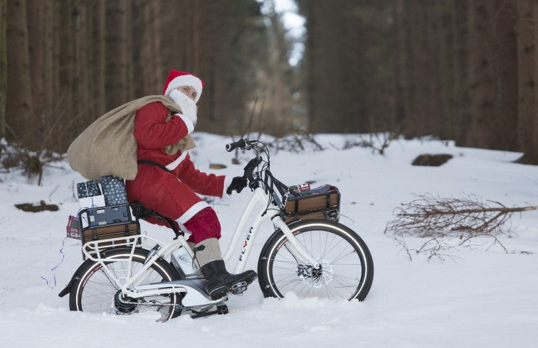Santa riding an electric bike.