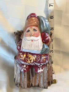 Exquisite hand-carved Grandfather Frost on a stump