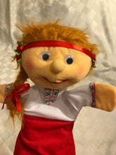 Ukrainian puppet with red headband