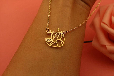 Image of Geometric Hanging Sloth Necklace Pendant Necklaces Light Yellow Gold Color