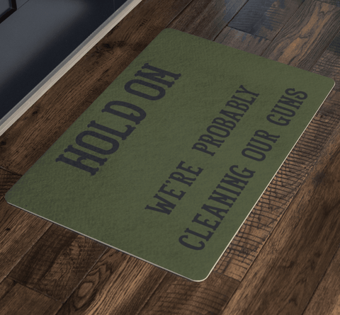 Image of Hold On - We're Probably Cleaning Our Guns Doormat
