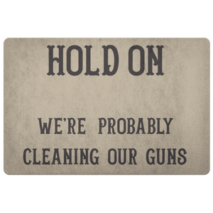 Hold On - We're Probably Cleaning Our Guns Doormat Khaki