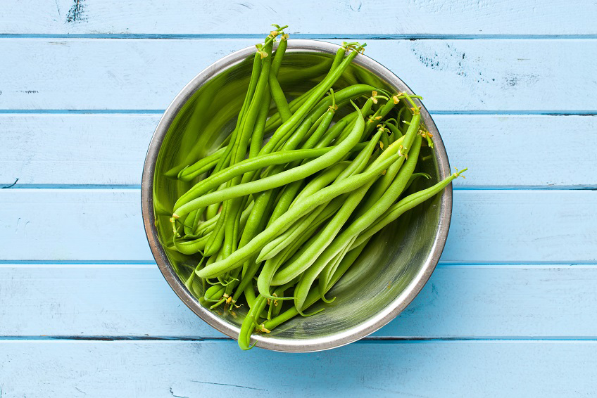the green beans on blue kitchen table